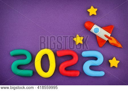 The New Year 2022. The Space Rocket And Numbers Are Made Out Of Play Clay (plasticine).