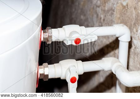 Boiler With Two Pipes That Lead Water From The Fuel Boiler And To The Hot Water Main. Heating Water