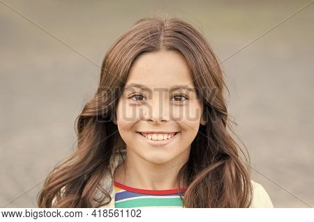Beauty For Tomorrow. Happy Beauty Smile Grey Background. Beauty Look Of Little Girl. Small Kid With