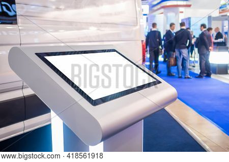Electronic Multimedia Kiosk With Blank White Display At Exhibition, Trade Show, Conference - Close U