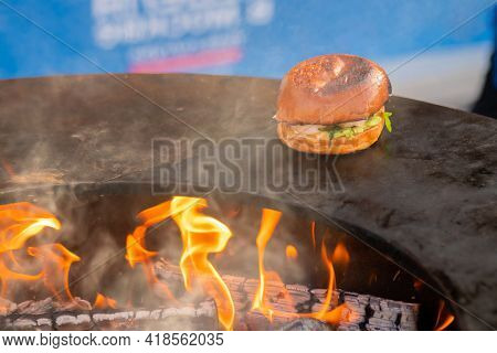 Process Of Preparing Fish Burger With Shrimp, Prawn On Brazier With Hot Flame At Summer Local Food M