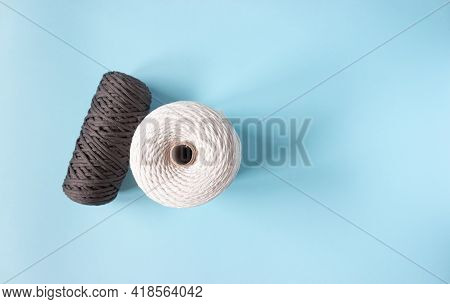 A Skein Of Cotton Cord And Polyester Cord On A Blue Background, Free Space.
