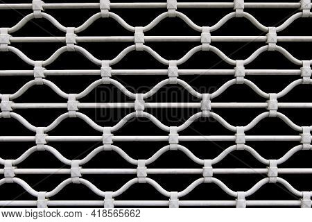 Openwork Forged Lattice Isolated On A Black Background.
