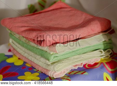 A Pile Of Neatly Folded Towels In A Pile In The Bathroom
