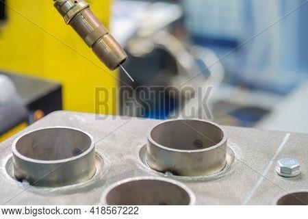 Industrial Welding Robot For Gas Metal Arc Welding Working With Metal Workpiece At Robotic Exhibitio