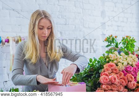 Professional Woman Floral Artist, Florist Making Gift Box With Flowers At Workshop, Flower Shop. Flo