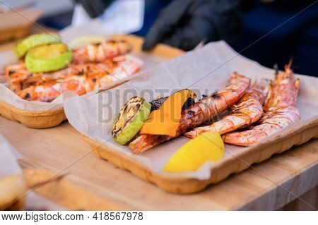 Cooked Fresh Red Langoustine Shrimps, Prawns In Paper Take Out Boxes At Summer Local Food Market - C