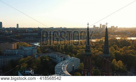 Warsaw, Poland 12.01.2020 - Aerial View Of The City Of Warsaw. Lush Green Trees Against The Cloudy B