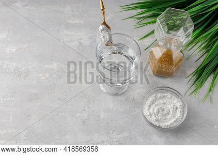 A Glass Of Water, Collagen Powder On A Light Background. Healthy Lifestyle Concept. Hydrolyzed Colla