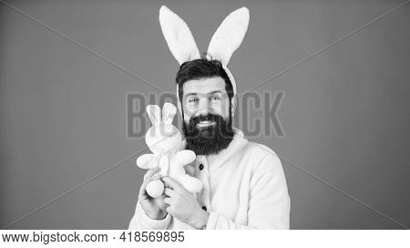 Easter Symbol Concept. Guy Bearded Hipster Cute Gentle Bunny Long Ears Blue Background. Respect For