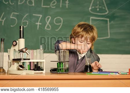 School Kid Scientist Studying Science. Little Boy At Lesson. Back To School. Science Experiments Wit