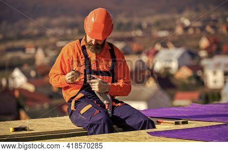 Install Vapor Barriers Or Layers Of Insulation On Flat Roofs. Roofer Constructing Roof. Master Repai