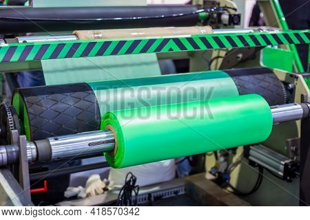 Part Of Automatic Plastic Bag Making Machine - Moving Roller With Flat Polyethylene Green Film At Ex