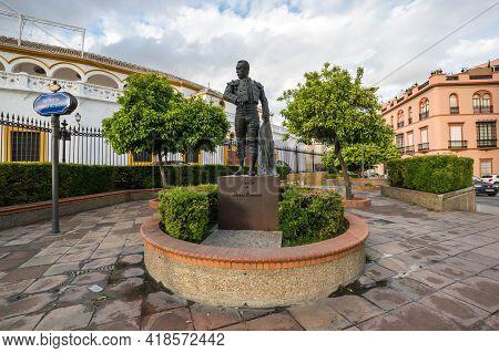 Seville, Spain - 08 April, 2019: Statue Of A Toreador In Front Of The Plaza De Toros De La Maestranz