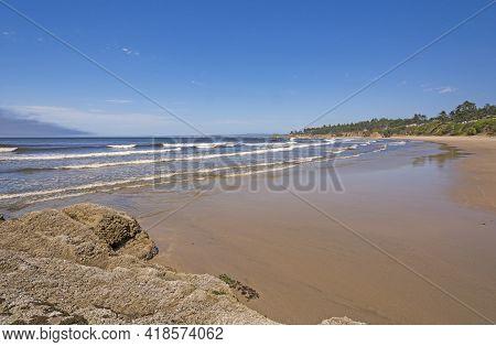 Ocean Waves On A Remote Beach On Lighthouse Beach Near Charleston, Oregon