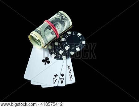 Poker Game With A Three Of A Kind Or Set Combination And Dollars. Chips And Cards On The Black Table