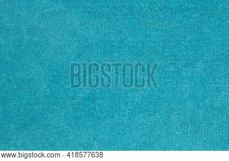Turquoise polyester fabric as background