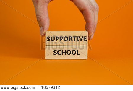 Supportive School Symbol. Wooden Blocks With Words 'supportive School' On Beautiful Orange Backgroun