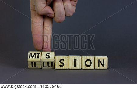 Mission Or Illusion Symbol. Businessman Turns Wooden Cubes And Changes The Word 'mission' To 'illusi