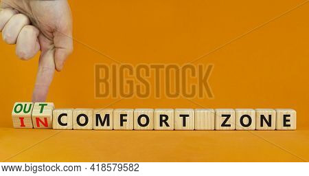 Out Or In Comfort Zone Symbol. Businessman Turns Wooden Cubes And Changes Words 'in Comfort Zone' To