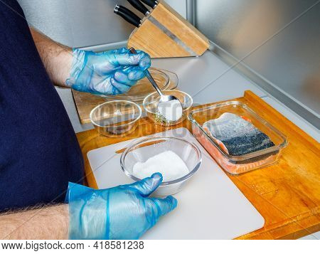 A Cook Wearing Hygienic Gloves Prepares A Mixture For Salting Salmon Fillets. The Process Of Cooking