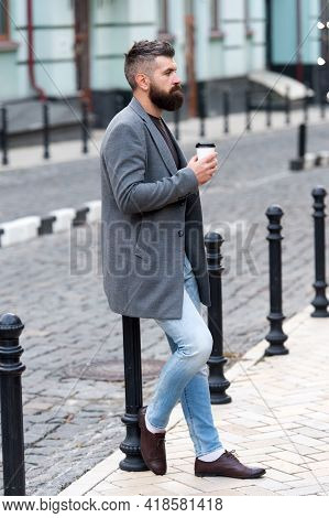 Waiting For Someone In Street. Man Bearded Hipster Drink Coffee Paper Cup. Businessman Well Groomed