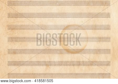 Abstract Background Of A Brown Blank Sheet Of Music With A Round Spot. Worn Yellowed Page Of A Music