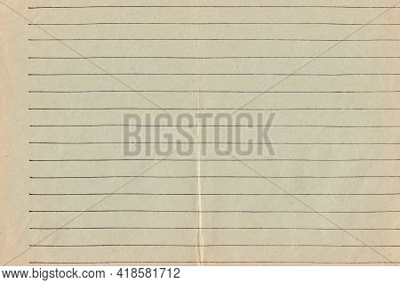 Old Greenish-brown Lined Sheet Of Paper With An Uneven Fold In The Middle. A Blank Page Of A Vintage