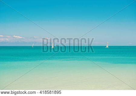 Catamarans With Sail On Calm Surface Of Sea Lagoon Sunny Day. Recreational Sport Catamaran. Boating