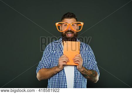 Nerdy And Funny. University Male Student With Lecture Notes. Study Nerd Holding Book. Book Nerd Wear