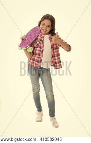 Nice Board. Kid Girl Happy Holds Penny Board. Modern Teen Hobby. Girl Happy Face Carries Penny Board