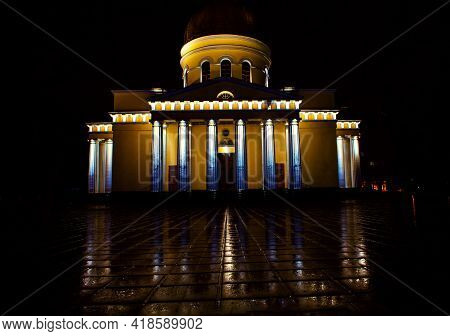 Cathedral With Columns In The Night . Neoclassical Architecture Of Church  . Rainy Night . Main Cath