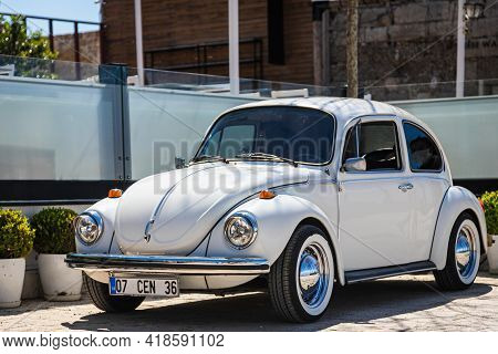 Side, Turkey - April 15 2021: Vintage White  Car Volkswagen Beetle On The Background Of A City Stree
