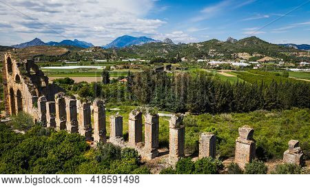 Roman Aqueduct Of The Ancient City Of Aspendos, Turkey. Ancient Bridge Structure With A Canal For Su