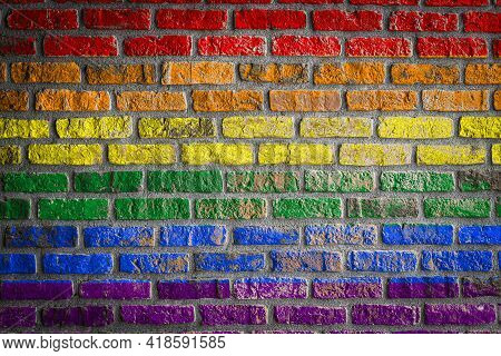 Flag Of Lgbt  Depicting In Paint Colors On An Old Brick Wall. Flag  Banner On Brick Wall Background.