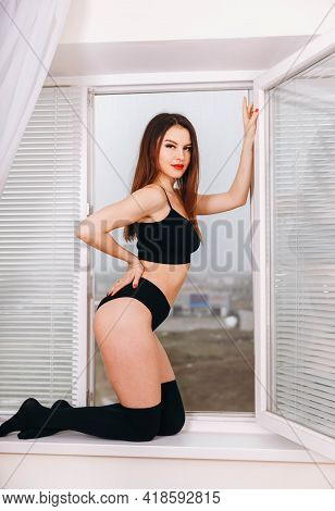 Cute Young Woman Wearing Sexy Lingerie. Sexy Fashion Model In Beautiful Underwear. Attractive Young