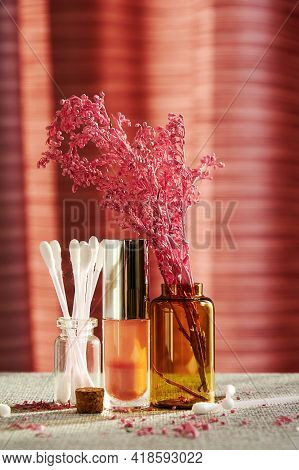 Makeup Store Desk With Sunlit Bottles, Lipstick And Cotton Buds. Fashion And Makeup Concepts And Bac