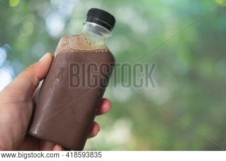 Cool Mocha Coffee In Plastic Bottle In Hand, Ready To Drink Quite Popular During Pandemic Covid-19