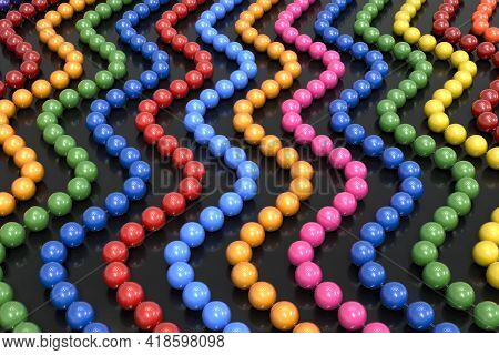 Background From Multi-colored Plastic Beads On A Transparent Line. The Beads Are Arranged In A Verti