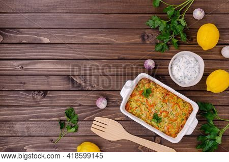 Vegetable Casserole With Shrimp On A Dark Wooden Background. Selective Focus.