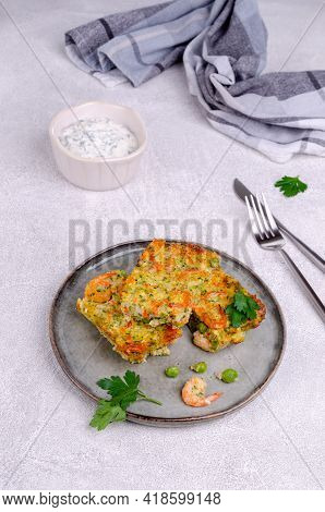 Vegetable Casserole With Shrimp On A Light Gray Background. Selective Focus.