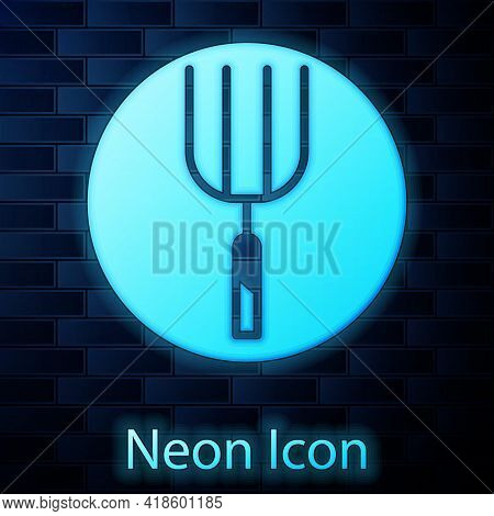 Glowing Neon Garden Pitchfork Icon Isolated On Brick Wall Background. Garden Fork Sign. Tool For Hor