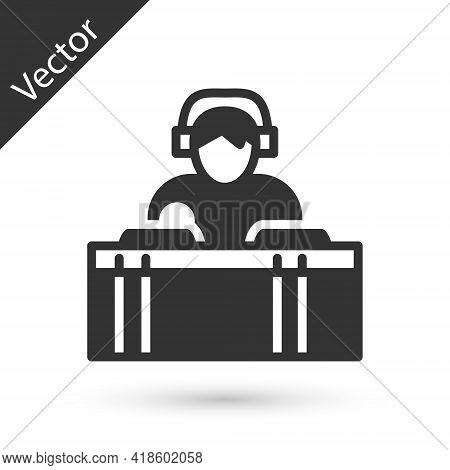 Grey Dj Wearing Headphones In Front Of Record Decks Icon Isolated On White Background. Dj Playing Mu