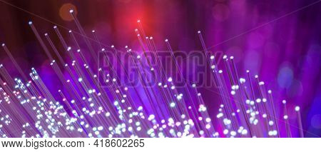 Fiber optics network cable on technology background