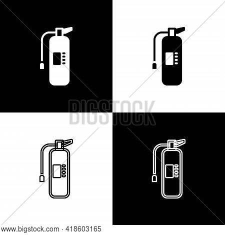 Set Fire Extinguisher Icon Isolated On Black And White Background. Vector
