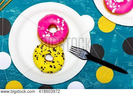 A Plate Of Donuts. Donuts In Colored Glaze. Sweet Donuts.