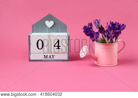 Calendar For May 4: Cubes With The Numbers 0 And 4, The Name Of The Month Of May In English,a Pink W