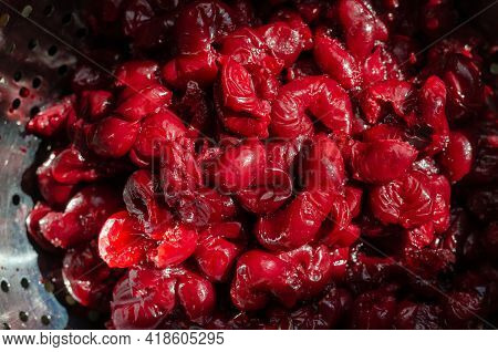 Fresh Thawed Seedless Cherries In A Metal Colander. Close-up Of Ripe Berries Ready To Eat. Berries F
