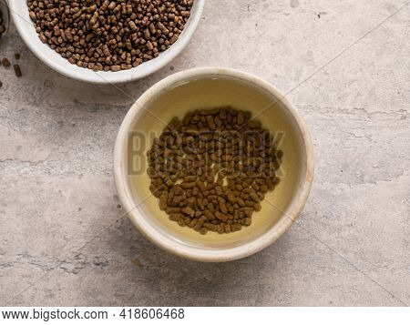Top View Of Healthy Soba Tea And Groats Of Tartary Buckwheat  Ku Qiao Seeds On Light Background. Fla