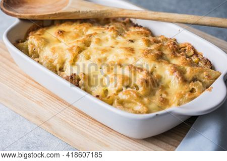 Tetrazzini -chicken Pasta Casserole In A Baking Dish With Ingredients At Background, American Cuisin